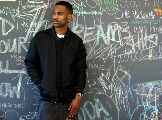 Big Sean standing in front of a chalkboard