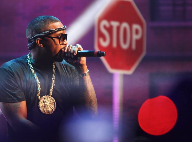 Nas in front of a stop sign
