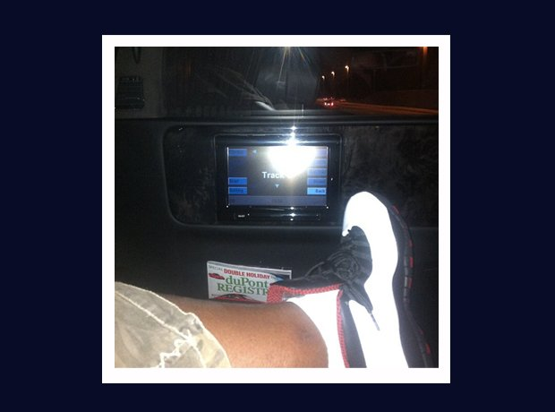 Rick Ross Instagram trainers in car