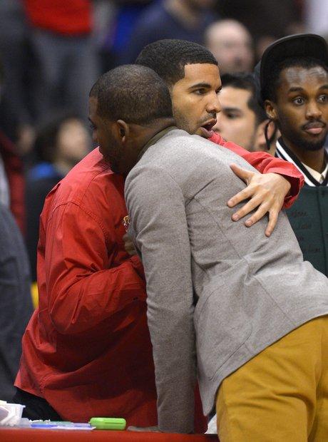 Drake hugs Los Angeles Clippers' Chris Paul