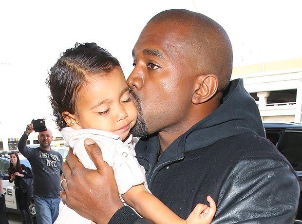 Kanye West Kissing North