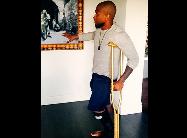 Usher gold crutches