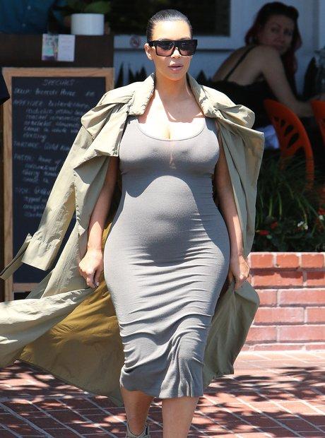 Kim Kardashian shows off baby bump