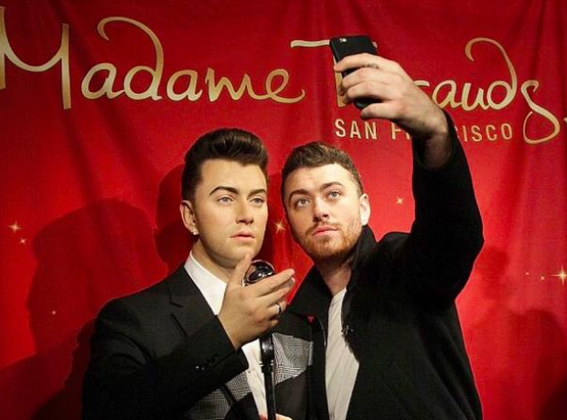 Sam Smith with his wax work at Madame Tussauds