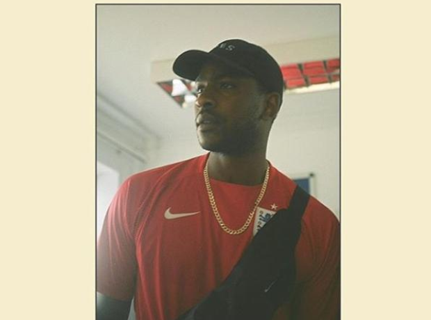 Skepta wearing England football shirt