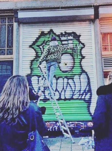 Chris Brown spray painting on wall