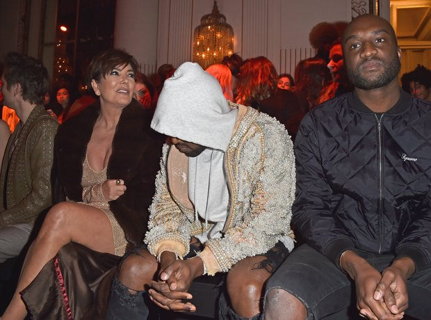 Kanye West looking bored at the Balmain PFW show