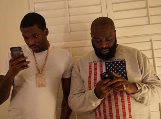 Meek Mill and Rick Ross looking at mobile phones