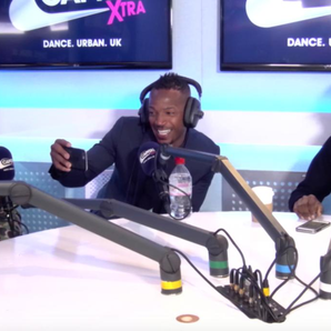 Krept & Konan sat with Marlon Wayans at a table