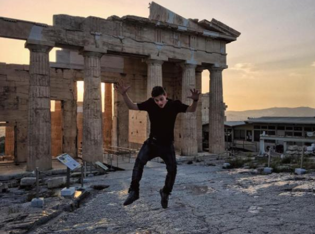 Martin Garrix jumping in front of parthenon