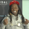 Image 7: Lil Wayne wearing the key to Lafayette