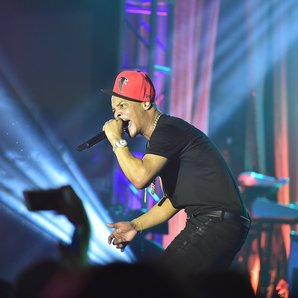 TI performing on stage