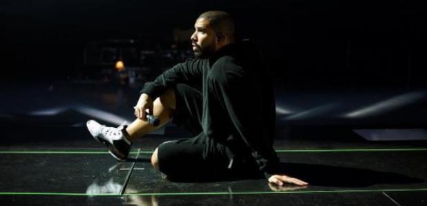 Drake sitting on the floor
