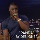 Idris Elba holding microphone