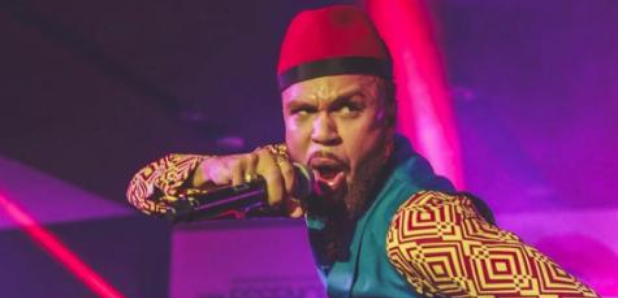 Jidenna performing on stage