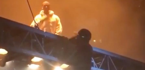 Kanye West Fan climbing floating stage