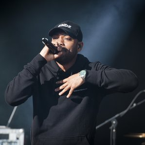 Kano Performing On Stage