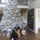 Image 3: Kylie Jenner and Tyga under a Christmas tree