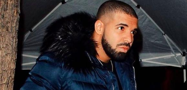 Drake Wearing A Blue Padded Jacket