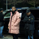 Image 10: Drake in a pink Stone Island coat